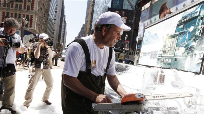 COMMERCIAL IMAGE - In this image provided by HISTORY, Arctic Glacier Special Effects Team joins HISTORY and Arctic Glacier to Launch IRT Ice to create an ice sculptor in Times Square on Thursday May 31, 2012 in New York. (Photo by Amy Sussman/Invision for History )