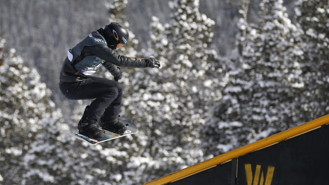 Shaun White, of the United States, slides off a rail during the U.S. Grand Prix slopestyle snowboarding finals, Sunday, Dec. 22, 2013, in Frisco, Colo. White finished third in the event. (AP Photo/Julie Jacobson)