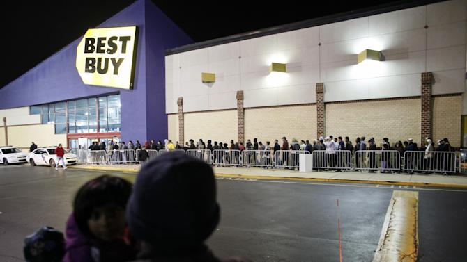 FILE - In this Thursday Nov 22, 2012 file photo, people wait in line for a Best Buy store to open in Northeast Philadelphia. Best Buy Co. says its fourth-quarter loss narrowed as it cut costs to offset nearly flat sales during the key holiday quarter. The financial results beat expectations and shares rose more than 6 percent in premarket trading. (AP Photo/Joseph Kaczmarek, File)