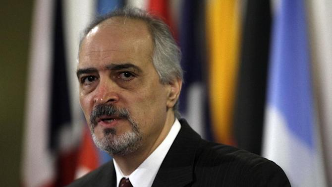 Syria's UN Ambassador Bashar Jaafari answers media questions after Security Council consultations, at United Nations headquarters, Thursday, Nov. 29, 2012. (AP Photo/Richard Drew)