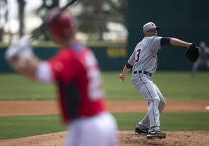 Detroit Tigers pitcher Drew Smyly delivers a pitch to Washington Nationals' Adam LaRoche during the second inning of an exhibition spring training baseball game on Friday, March 22, 2013, in Viera, Fla. (AP Photo/Evan Vucci)
