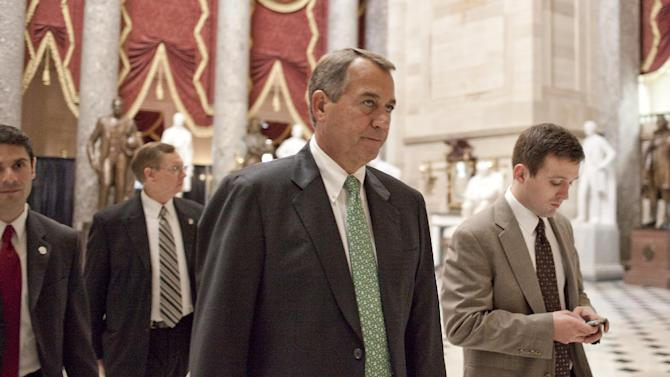 House Speaker John Boehner of Ohio walks from the House floor on Capitol Hill in Washington, Tuesday, Nov. 13, 2012, as the lame duck 112th Congress session began. (AP Photo/Harry Hamburg)