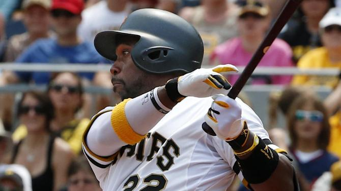 Pittsburgh Pirates' Andrew McCutchen (22) drives in two runs with a double off Cleveland Indians starting pitcher Danny Salazar during the fifth inning of a baseball game in Pittsburgh Sunday, July 5, 2015.(AP Photo/Gene J. Puskar)