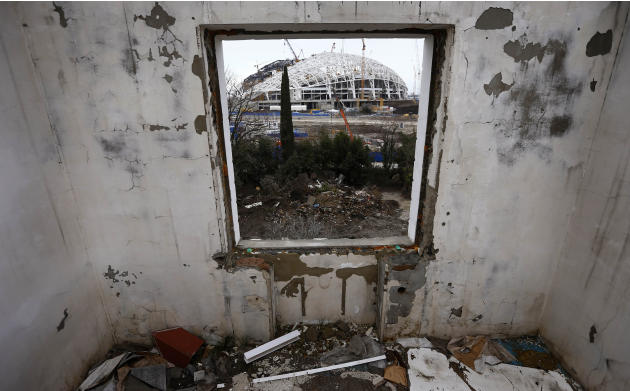 A picture shot through a window shows the Olympic stadium for the Sochi 2014 Winter Olympics at the Olympic Park in Adler