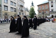 Nuns of the Ukrainian Orthodox Greek Catholic Church (UOGCC) stage a protest in Lviv on June 10. The Euro 2012 football tournament is providing the perfect platform to air a range of local and national grievances in the former Soviet state. The day after Germany's 1-0 victory over Portugal, it was the turn of the nuns as well as purists of the Ukrainian language to demonstrate
