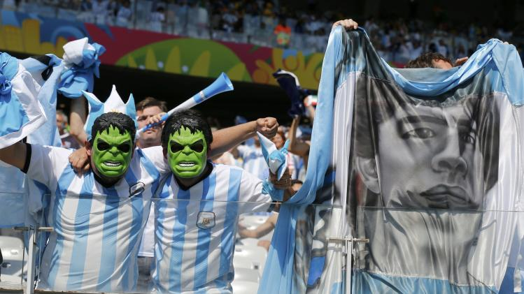 Fans of Argentina, wearing a masks of comic character the Hulk, pose before their 2014 World Cup Group F soccer match against Iran at the Mineirao stadium in Belo Horizonte
