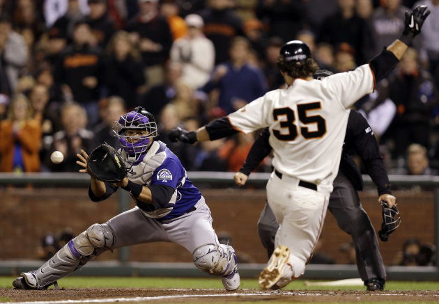 Colorado Rockies catcher Wilin Rosario, left, catches the relay from the outfield and tags out San Francisco Giants' Brandon Crawford, who was trying to score on a single from Angel Pagan, during the fifth inning of a baseball game on Monday, Sept. 17, 2012, in San Francisco. (AP Photo/Marcio Jose Sanchez)