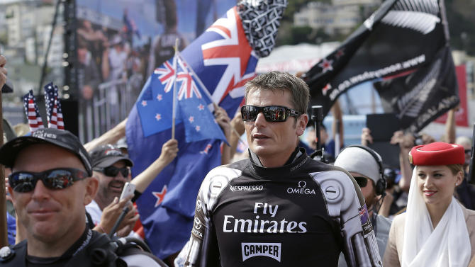 Emirates Team New Zealand skipper Dean Barker, center, walks to the stage during the Dock Out Show before the 13th race of the America's Cup sailing event against Oracle Team USA on Friday, Sept. 20, 2013, in San Francisco. (AP Photo/Jeff Chiu)