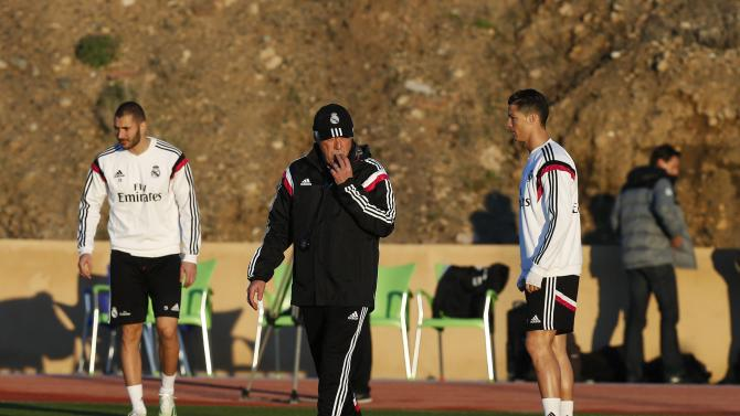 Real Madrid's coach Carlo Ancelotti gestures during a training session one day ahead of their Club World Cup final against San Lorenzo at Marrakech stadium