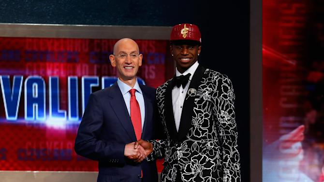 Andrew Wiggins (R) of Kansas poses for a photo with NBA Commissioner Adam Silver after Wiggins was drafted #1 overall in the first round by the Cleveland Cavaliers during the 2014 NBA Draft at Barclays Center on June 26, 2014 in Brooklyn