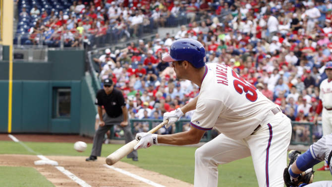 Philadelphia Phillies' Cole Hamels bunts against the Los Angeles Dodgers in the third inning of a baseball game on Sunday, Aug. 18, 2013, in Philadelphia. (AP Photo/H. Rumph Jr)
