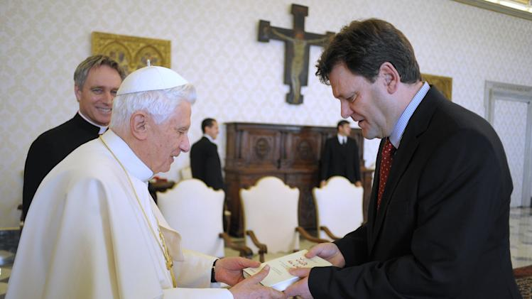 "In this picture made available by the Vatican newspaper Osservatore Romano Pope Benedict XVI, left, receives by German journalist Peter Seewald  a copy of the book  ""Light of the World'', during a private audience at the Vatican, Tuesday, Nov. 23, 2010. The Vatican broadened the scope of the pope's comments about condom use being a lesser evil than transmitting HIV by saying the concept also applies to women. The Pontiff said in the book that condom use by people such as male prostitutes was a lesser evil since it indicated they were taking a step toward a more moral and responsible sexuality by aiming to protect their partner from infection. (AP Photo/Osservatore Romano, HO) EDITORIAL USE ONLY"