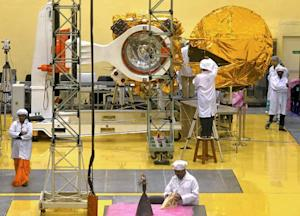 Indian scientists and engineers work on a Mars Orbiter …