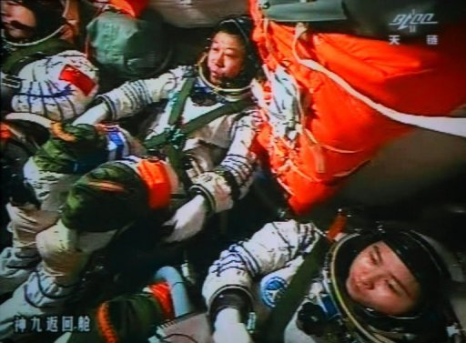 Three Chinese astronauts successfully carried out China's first manual space docking with the orbiting Tiangong-1 module