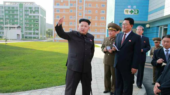 North Korean leader Kim Jong-Un (L), seen during an inspection tour of a newly-built housing complex in Pyongyang, in October 2014