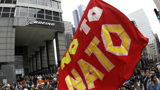 Protesters demonstrate outside Boeing's corporate offices Monday, May 21 2012, in Chicago, on the final day of the NATO summit. (AP Photo/Charles Rex Arbogast)