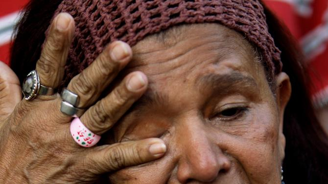 A supporter of Venezuela's President Hugo Chavez cries as she attends a celebration marking his return to his country at Bolivar square in Caracas, Venezuela, Monday, Feb. 18, 2013. Chavez returned to Venezuela early Monday after more than two months of medical treatment in Cuba following cancer surgery, and was being treated at the Caracas' military hospital, his government said. (AP Photo/Fernando Llano)