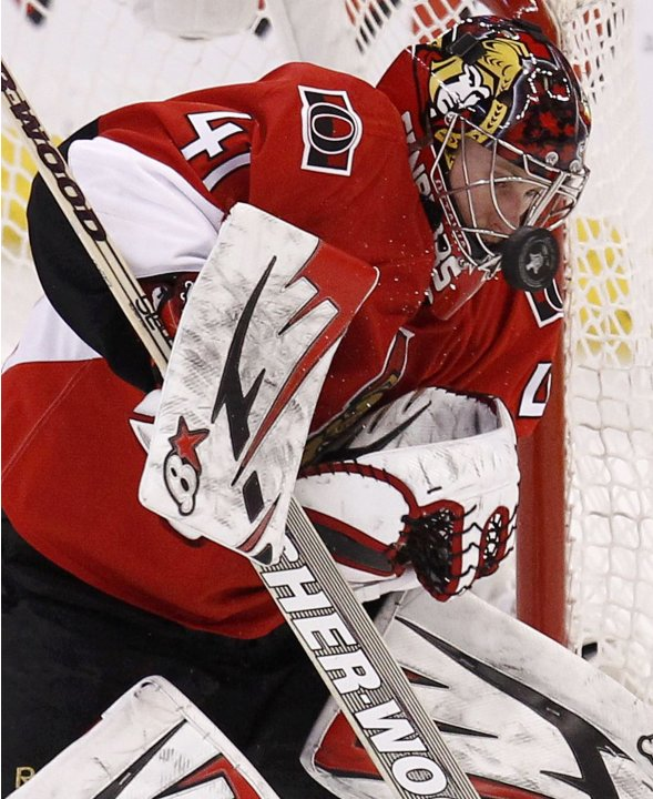Senators goalie Anderson makes a save against the Pittsburgh Penguins during the second overtime in Game 3 of their NHL Eastern Conference semi-final playoff hockey game in Ottawa