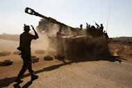 An Israeli army vehicle on a military exercise in the Golan Heights. Israeli PM Benjamin Netanyahu and Defence Minister Ehud Barak began indirect negotiations with Syria&#39;s Bashar al-Assad on the Golan Heights, says a report