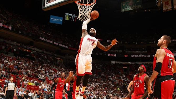 Heat move atop East, beat Raptors 93-83