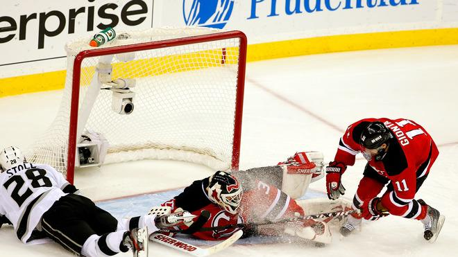Martin Brodeur #30 Of The New Jersey Devils Makes A Save In Front Of Stephen Gionta #11 And Jarret Stoll #28 Of The  Getty Images