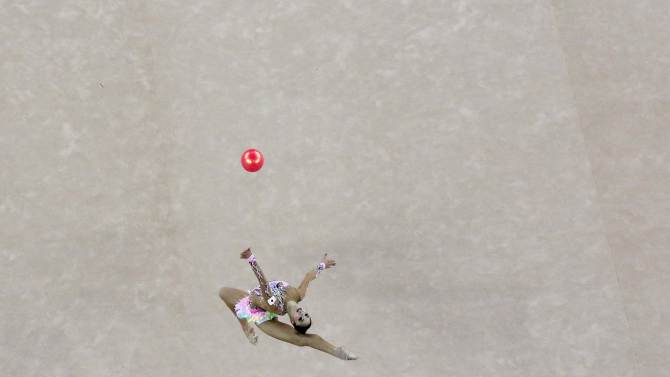 Japan's Kaho Minagawa performs with the ball in the individual rhythmic gymnastics qualification and team final at the Namdong Gymnasium Club during the 17th Asian Games in Incheon
