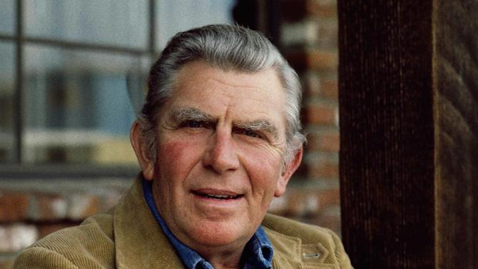 "FILE - This Jan. 1983 file photo shows actor Andy Griffith posing in Los Angeles to promote his upcoming CBS-TV film, ""Murder in Coweta County"". Griffith, whose homespun mix of humor and wisdom made ""The Andy Griffith Show"" an enduring TV favorite, died Tuesday, July 3, 2012 in Manteo, N.C. He was 86. (AP Photo/Wally Fong, file)"