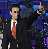 FILE - In this May 15, 2007, file photo, The Bee Gees&#39; Robin Gibb salutes the crowd after The Bee Gees were named BMI Icons during the 55th Annual BMI Pop Awards in Beverly Hills, Calif. A representative said on Sunday, May 20, 2012, that Gibb has died at the age of 62. (AP Photo/Chris Pizzello, File)