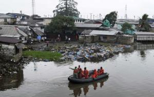 Liberian security forces patrol the waters around the Ebola quarantine area of West Point to stop residents crossing to the city centre of Monrovia
