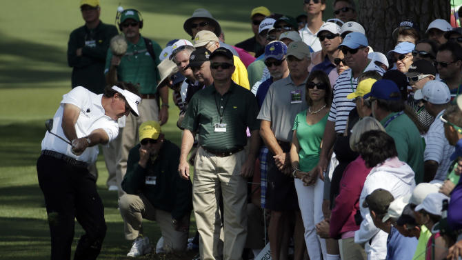 Mickelson headed home after missing Masters cut