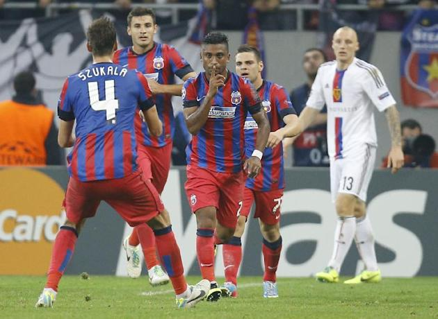 Steaua's Leandro Tatu, center, reacts after scoring against Basel during the UEFA Champions League group E soccer match between Steaua Bucharest and FC Basel, in Bucharest, Romania, on Tuesday, Oct. 2