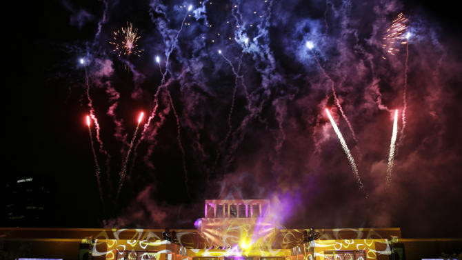 Fireworks burst as a part of the celebration during the lighting of Freedom Hall at the George W. Bush Presidential Center Thursday, April 25, 2013, in Dallas. (AP Photo/David J. Phillip)