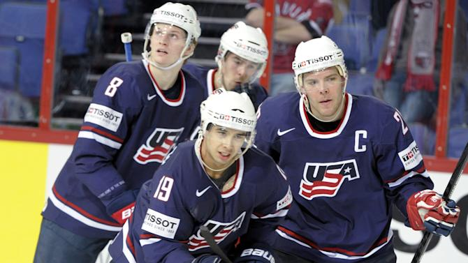USA's goal scorer Tim Stapleton, center, and captain Paul Stastny, right, celebrate the team's equalizer during the 2013 Ice Hockey IIHF World Championships Group B match Latvia vs USA in Helsinki, Finland, on Sunday May 5, 2013. (AP Photo / LEHTIKUVA,  Jussi Nukari) FINLAND OUT - NO SALES