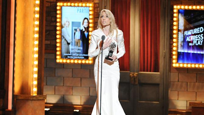"""Actress Judith Light accepts the award for Best Performance by an actress in a featured role in a play for her role in """"The Assembled Parties,"""" at the 67th Annual Tony Awards, on Sunday, June 9, 2013 in New York.  (Photo by Evan Agostini/Invision/AP)"""
