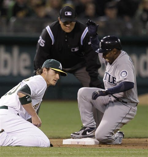 Mariners top A's 7-3 in stateside opening night