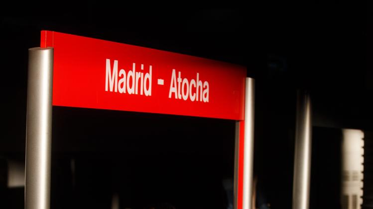 A man waits for a train at Atocha train station on the tenth anniversary of the Madrid train bombings