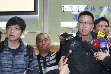 "File photo of student leaders of Taiwan's ""Sunflower Movement"" Lin Fei-fan and Chen Wei-ting talking to reporters at the Taipei District..."