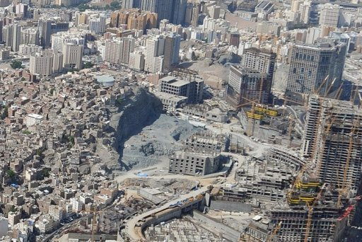 Aerial view of the Omar mountain development projects next to a slum area in the holy city of Mecca, Saudi Arabia.