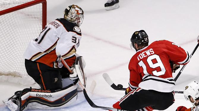 Anaheim Ducks goalie Frederik Andersen (31) stops a Chicago Blackhawks center Jonathan Toews (19) shot during the first period in Game 6 of the Western Conference finals of the NHL hockey Stanley Cup playoffs, Wednesday, May 27, 2015, in Chicago. (AP Photo/Charles Rex Arbogast)