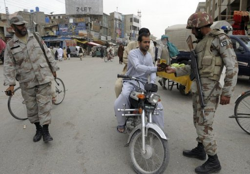 This file photo shows Pakistani paramilitary soldiers checking documents on a street in Quetta, in June. A suicide bomber blew up his explosive-laden car at a check post in southwestern Pakistan