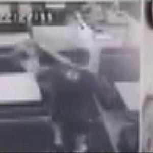 Security video shows off-duty cop appearing to assault woman