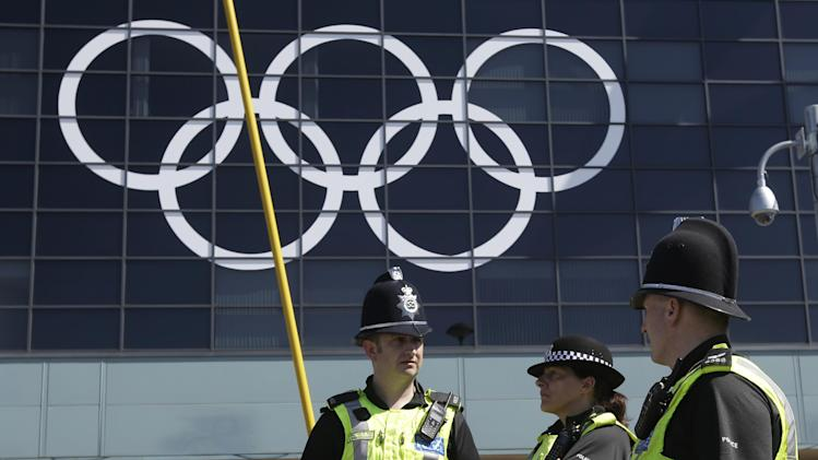 British police officers stand guard at one of main entrance of the city of Coventry stadium, in Coventry, England, Tuesday, July 24, 2012. Opening ceremonies for the 2012 London Olympics will be held Friday, July 27. (AP Photo/Hussein Malla)