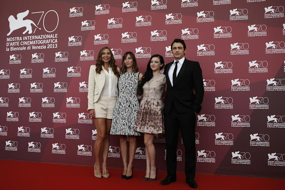 Actress Jacqui Getty, director, Gia Coppola, actors Claudia Levy and James Franco pose for photographers during the photo call for the film Palo Alto at the 70th edition of the Venice Film Festival held from Aug. 28 through Sept. 7, in Venice, Italy, Sunday, Sept. 1, 2013. (AP Photo/David Azia)