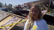 Destiny Young, 18, stands in front of the debris that once was her home after a storm hit southern Manitoba Sunday night.