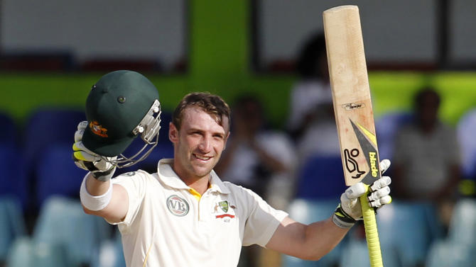 FILE - In this Sept. 19, 2011 file photo Australia's batsman Phillip Hughes celebrates after scoring a century during the fourth days' play of the third cricket test match between Australia and Sri Lanka in Colombo, Sri Lanka. Hughes died in a Sydney hospital on Thursday, Nov. 27, 2014, two days after being struck in the head by a cricket ball during a domestic first-class match. He was 25. (AP Photo/ Eranga Jayawardena, File)
