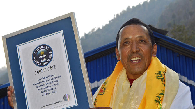 In this photo taken Monday, Feb. 27, 2012, veteran climber Apa Sherpa poses with his Guinness World Records certificate for the most number of successful ascents of Mount Everest, at Sindupalchok district, about 80 kilometers (50 miles) north of Katmandu, Nepal. Guinness officials have felicitated Sherpa for his world record of climbing Mt. Everest 21 times. (AP Photo/Dwarika Kafle)