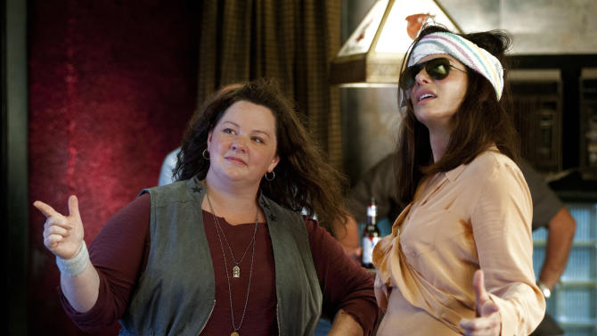 """This publicity photo released by Twentieth Century Fox shows Melissa McCarthy, left, as Detective Shannon Mullins, and Sandra Bullock as FBI Special Agent Sarah Ashburn, in a scene from the film, """"The Heat."""" The movie releases June 28, 2013. (AP Photo/Twentieth Century Fox, Gemma La Mana)"""