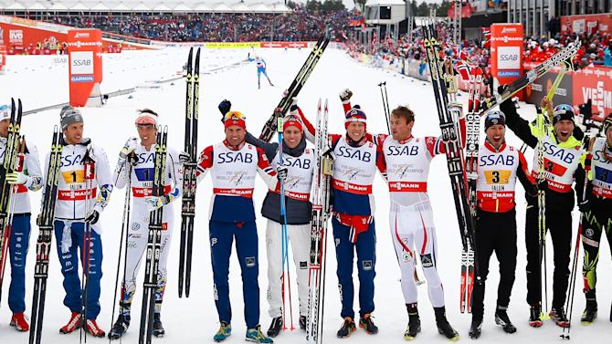 The teams of Sweden, Norway and France pose after the men's cross country free/classic 4 x 10 km relay final at the Nordic World Ski Championships in Falun