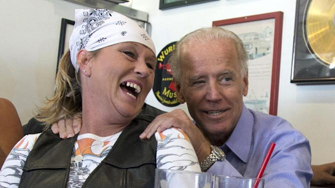 FILE - In this Sept. 9, 2012 file photo, Vice President Joe Biden visits with patrons over lunch at Cruisers Diner in Seaman, Ohio. Biden buddied up with bikers, posed for countless pictures at a pizza place. Obama goes airborne in a doozie of a bear hug with a pizza guy in Florida. Joe Biden cozies up with a biker chick in Ohio. Even the more reserved Mitt Romney seems to be loosening up some with people he meets on the campaign trail. Kissing babies and slapping backs are so yesterday. The 2012 candidates are putting their all into the campaign cliche of pressing the flesh. (AP Photo/Carolyn Kaster, File)