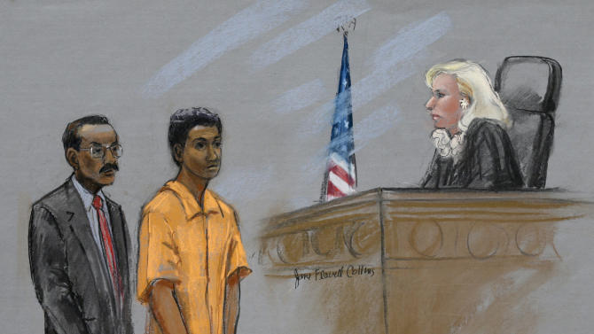 This courtroom sketch shows defendant Robel Phillipos, center, standing with his defense attorney Derege Demissie, left, before Federal Magistrate Marianne Bowler, right, in U.S. District Court in Boston, Monday, May 6, 2013.  Phillipos, a friend of Boston Marathon bombing suspect Dzhokhar Tsarnaev, was released from federal custody while he awaits trial for allegedly lying to federal investigators probing the bombings. (AP Photo/Jane Flavell Collins)